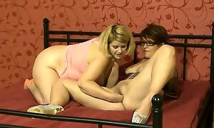 Wild mature lady has her lesbian lover fisting her wet pussy