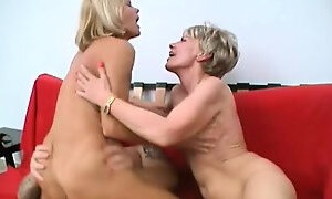 Two naughty ladies take turns fucking a young guys dick on the couch
