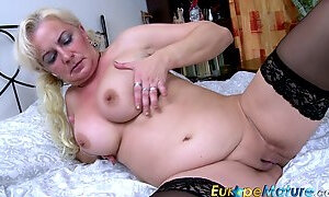 A bit chubby old whore in black stuff demonstrates her really kinky big tits
