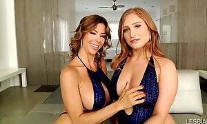 Bosomy babes are dressed alike and they use pink toy for wet cunts