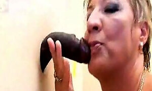 Sucking a big black mamba cock from a glory hole