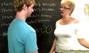 Shorthaired blonde gilf teacher strokes his hard cock