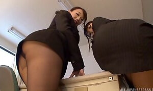 Two business ladies from Japan letting the guy cum on their booties