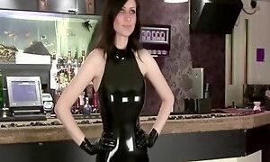 Stunning brunette in black latex dress