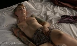 Tattoed Girl Stimulates Her Hairy Pussy