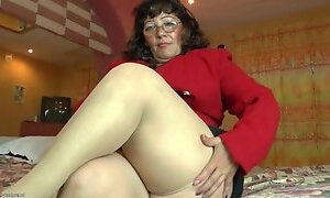 Fat mature in tan stockings masturbates